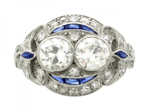 Two stone diamond and synthetic sapphire cluster ring, circa 1920.