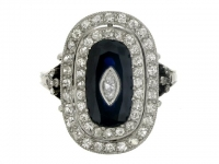 Sapphire and diamond cluster ring, French, circa 1915.