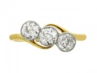Three stone diamond crossover ring, circa 1910.