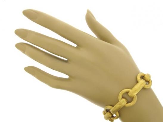 hand-view-18 carat gold link bracelet, circa 1960.