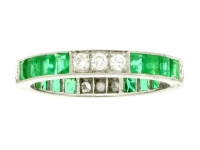 Emerald and diamond full eternity ring.