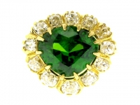 Rare demantoid and diamond cluster ring in yellow gold, circa 1900.
