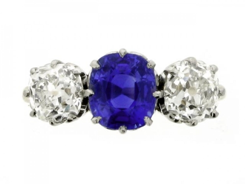 Three stone natural Kashmir sapphire and diamond ring, circa 1920.