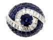 alt='Invisibly set sapphire and diamond ring, circa 1950.'