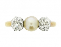 Antique pearl and diamond three stone ring, circa 1900.