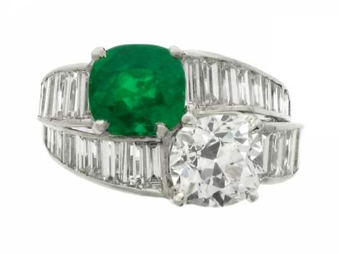 front view Tiffany & Co. emerald and diamond crossover ring, American, circa 1930.