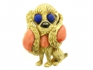 front view Mauboussin Paris dog brooch set with lapis, coral and onyx