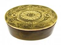 Gold topped stone box.
