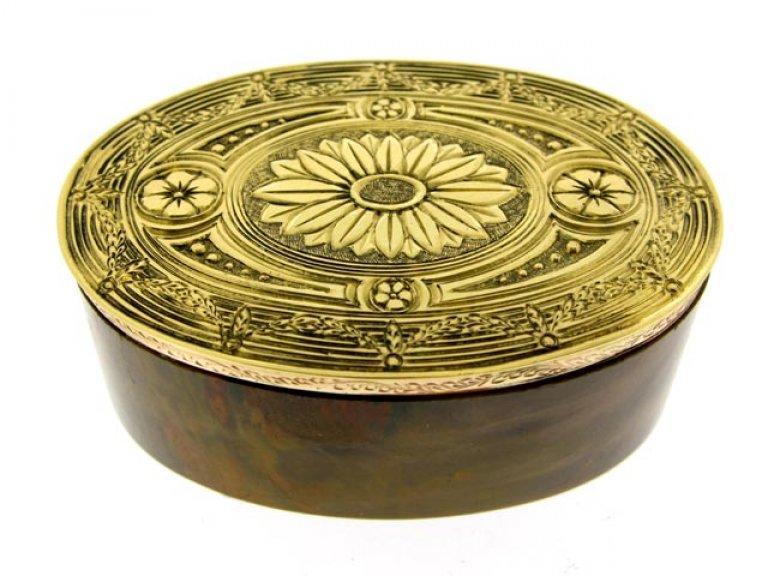 Gold topped stone box.