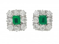 front view Antique emerald and diamond cluster earrings, circa 1915.