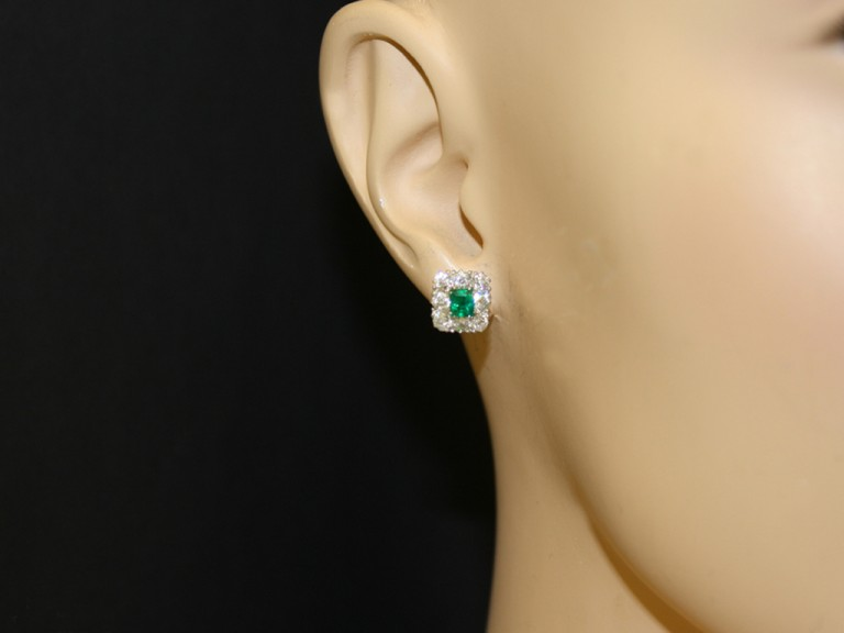 Antique emerald and diamond cluster earrings, circa 1915.
