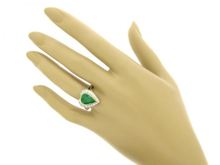 hand view Antique emerald and diamond coronet cluster ring, circa 1905.