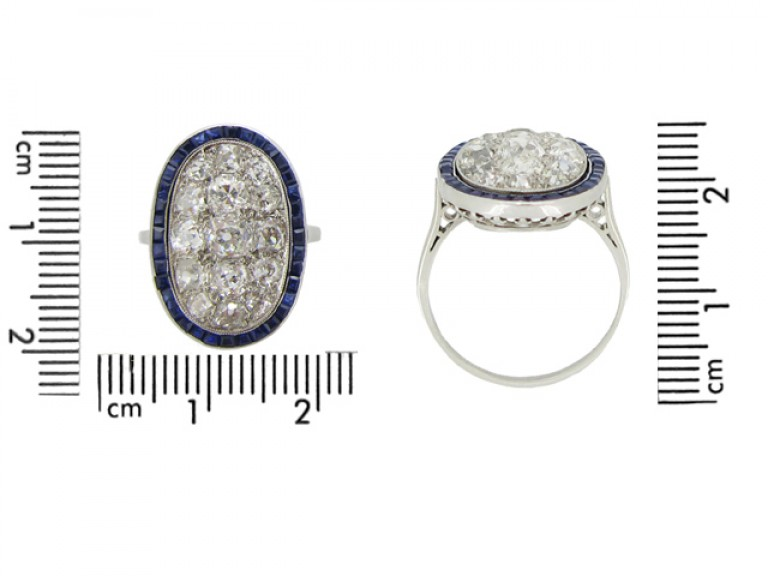 size view Diamond cluster ring with calibré sapphire border, circa 1910.