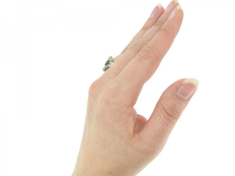 hand view Antique sapphire and diamond ring, circa 1905.