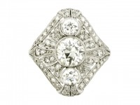 front view Three stone diamond cluster ring, circa 1920.