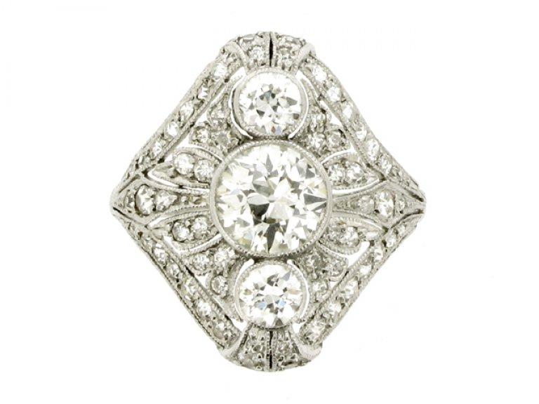 front view Three stone diamond cluster ring, circa 1920.