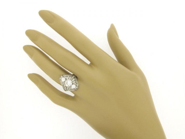 hand view Three stone diamond cluster ring, circa 1920.