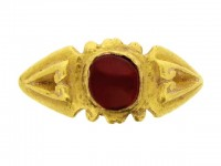 front view Ancient Roman Syrian garnet and gold ring, 3rd century AD.