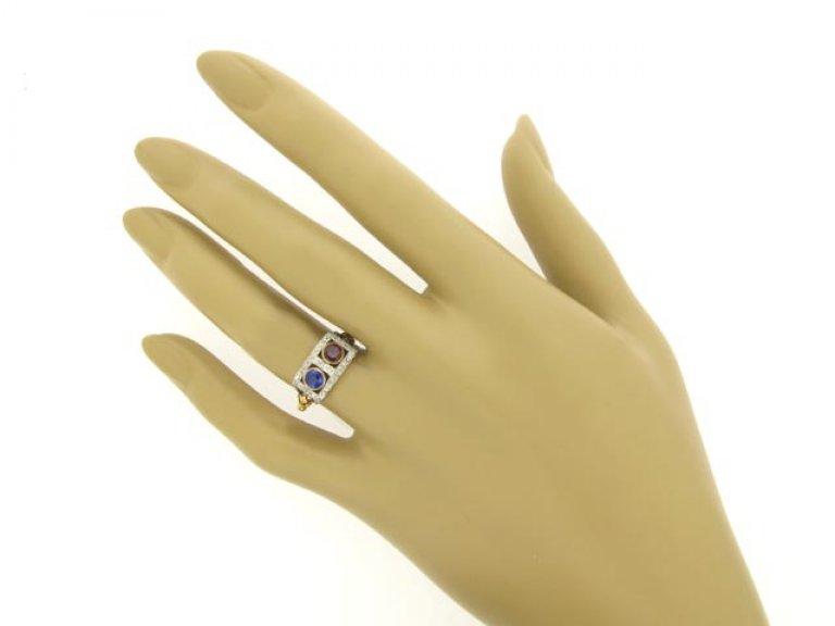hand view Edwardian sapphire, ruby and diamond ring, circa 1905.