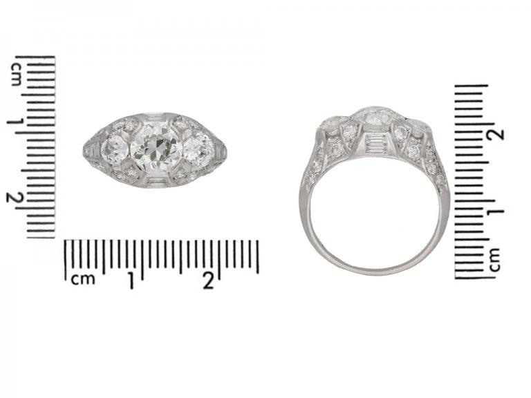 Ornate three stone diamond cluster ring, circa 1930.