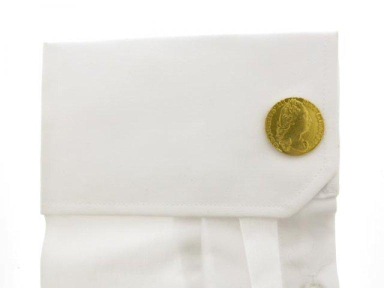 cuff view Gold coin cufflinks, circa 1970.