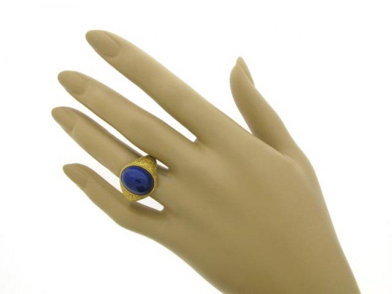 Cabochon lapis lazuli and gold ring, circa 1940.