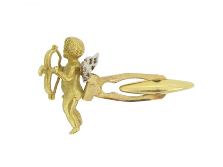 Pair of diamond set cherub cufflinks, circa 1960.