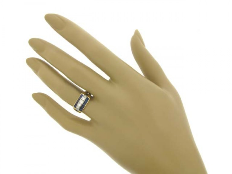 hand view Tiffany & Co. sapphire and diamond ring, American, circa 1940.