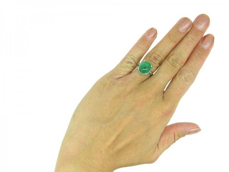 Colombian emerald cabochon and diamond ring, circa 1920.
