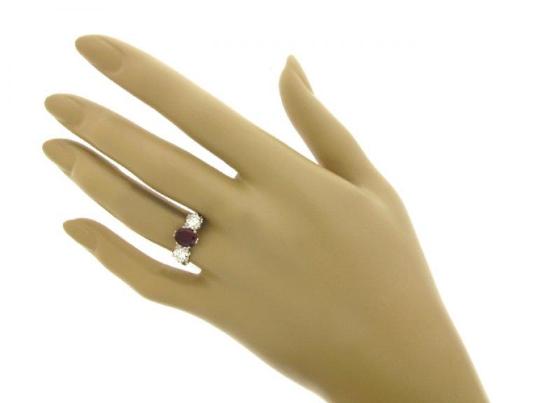 hand view Ruby and diamond three stone ring, English, circa 1950.