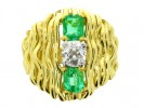 front view Emerald and diamond dress ring, English, circa 1978.