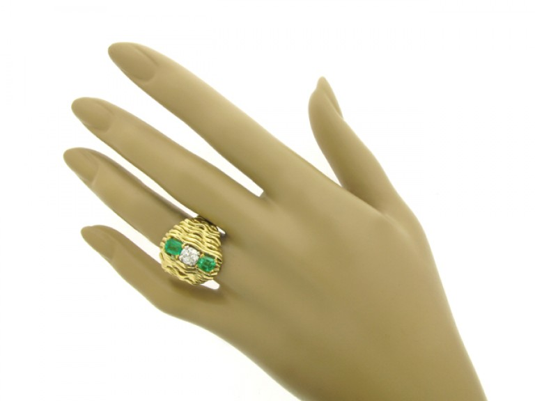 hand view Emerald and diamond dress ring, English, circa 1978.