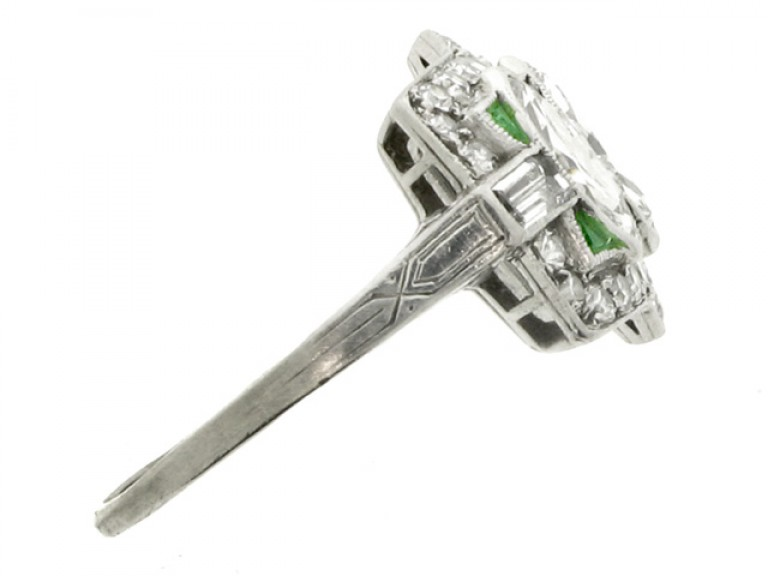 side view Marquise cut diamond and emerald diamond ring, circa 1920.