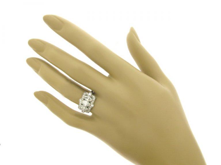 hand view Marquise cut diamond and emerald diamond ring, circa 1920.