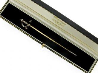 boxed view Diamond set sword jabot pin, circa 1890.