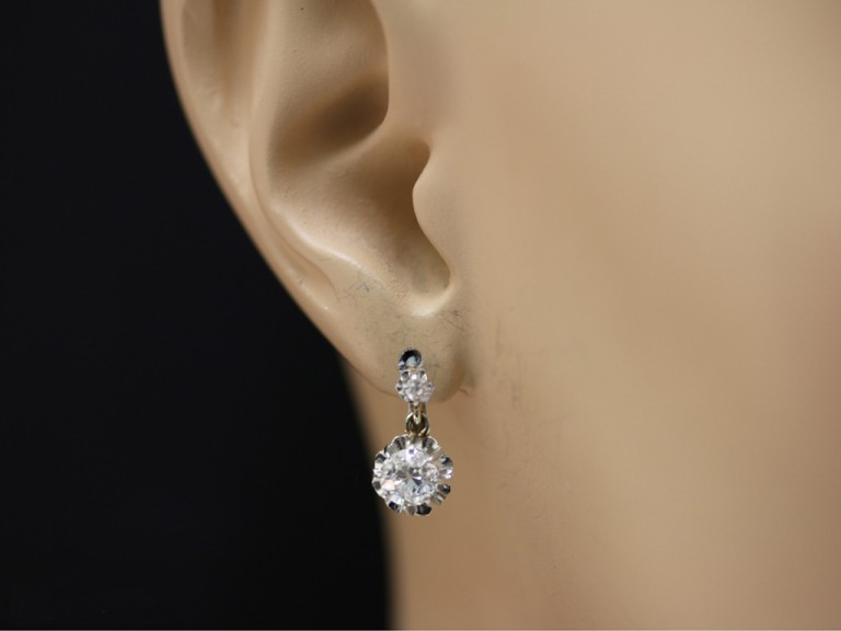 head view Diamond earrings, French, circa 1920.