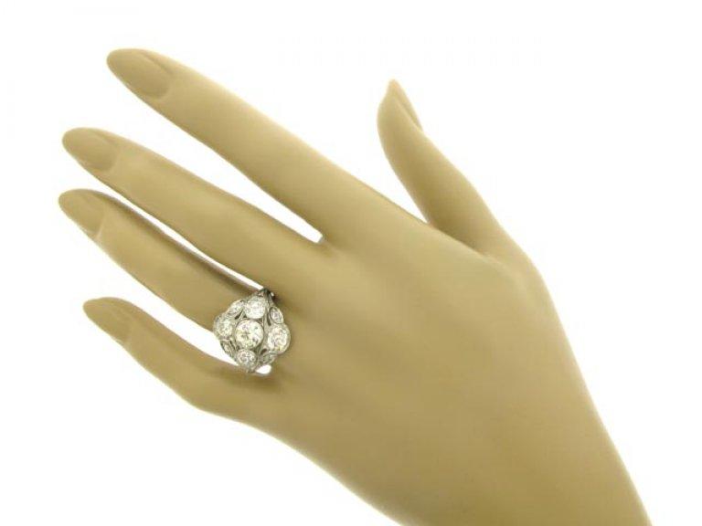 hand view Ornate diamond cluster ring, circa 1920.