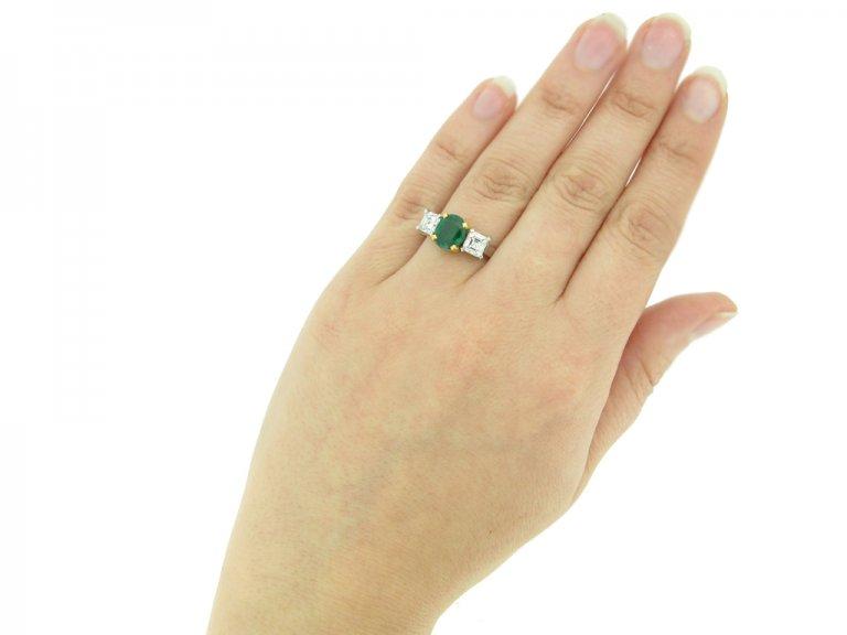 Three stone emerald and diamond ring, circa 1955.
