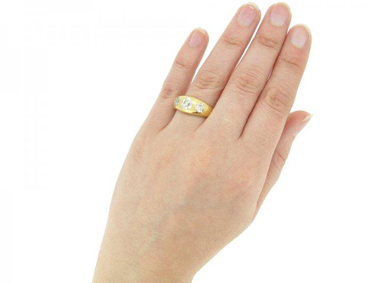 hand view Antique three stone diamond ring, circa 1900.