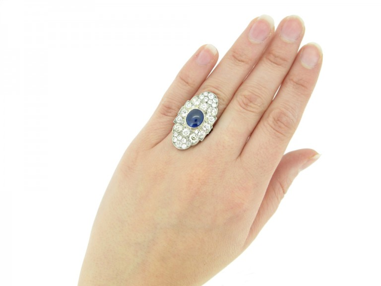hand view Cabochon Burmese sapphire and old cut diamond cluster ring
