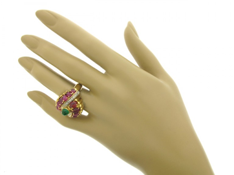 hand view Marchak cabochon emerald, carved ruby and diamond ring, French, circa 1950.