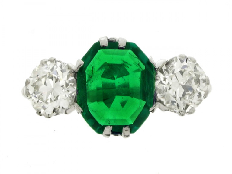 front view Edwardian old mine emerald and diamond three stone ring, circa 1910.