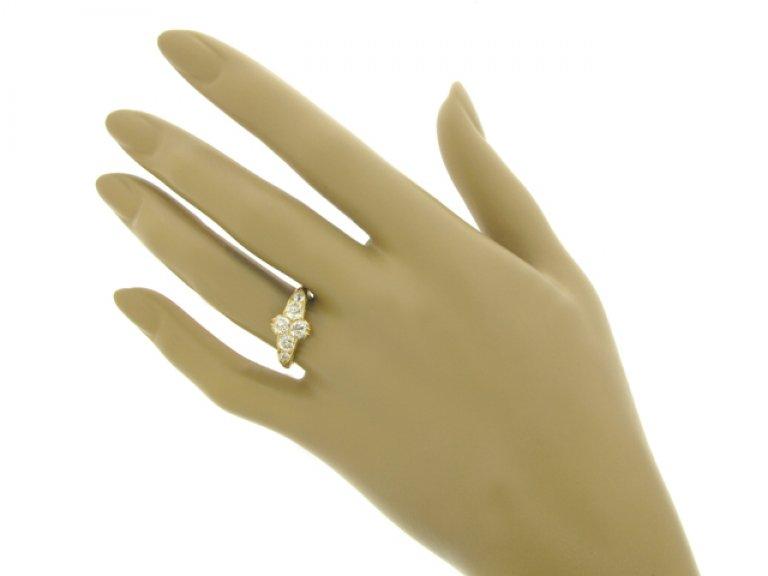 hand view Antique six stone diamond ring, English, circa 1891.