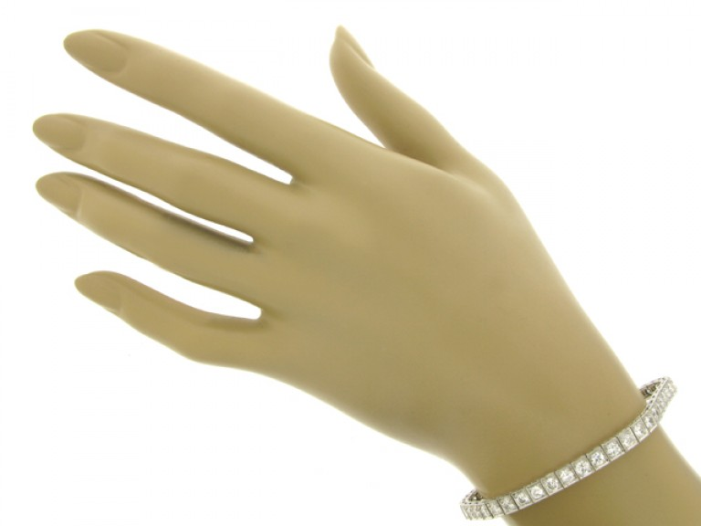 hand view Diamond set engraved line bracelet, circa 1935.