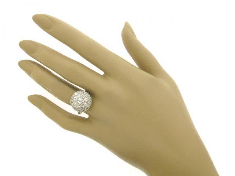 hand view Diamond coronet cluster ring, circa 1910.