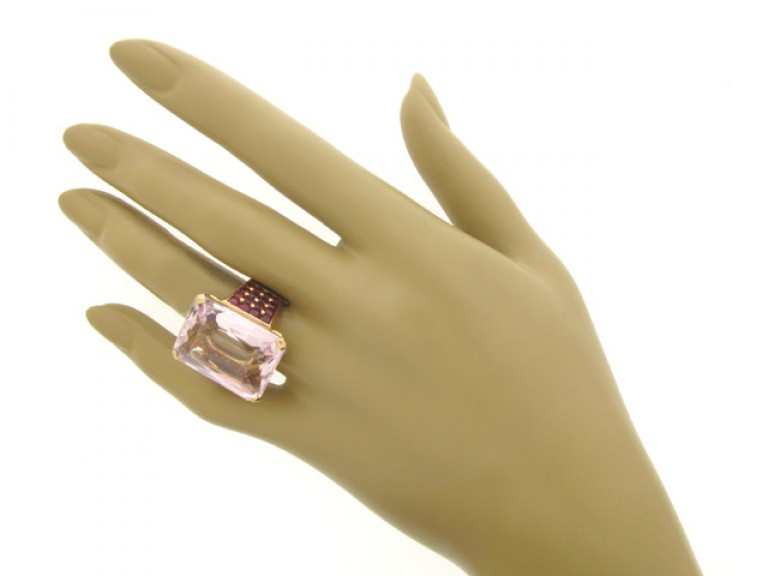 hand view Kunzite and ruby cocktail ring, circa 1940.