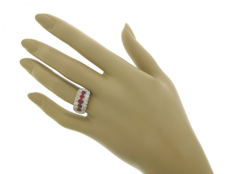 hand view Five stone ruby cluster ring, circa 1920.