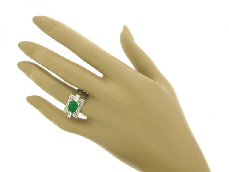hand view Emerald and diamond cocktail ring, French, circa 1940.