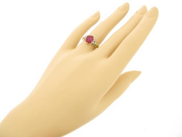 hand view Antique ruby and diamond ring, circa 1840.
