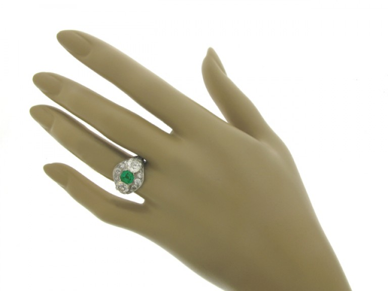 hand view Emerald and diamond ring, circa 1920.